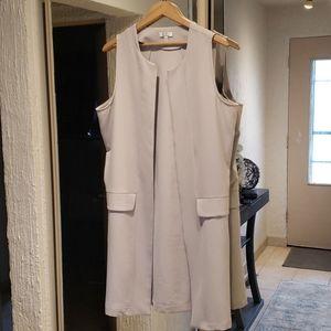Grey vest.
